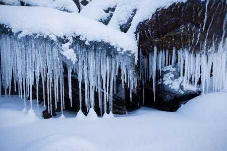 Row of big frosty icicles in nature 免版税图像