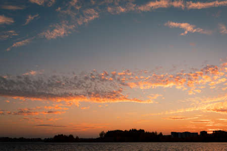 Cirrocumulus clouds sunset sky landscape at dusk 免版税图像