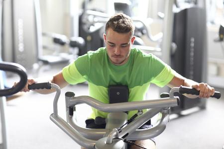 Teenage boy training in gym LANG_EVOIMAGES