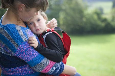 Kindergarten teacher consoling child in wood kindergarten LANG_EVOIMAGES