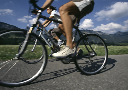 Underview, couple biking on rural road LANG_EVOIMAGES