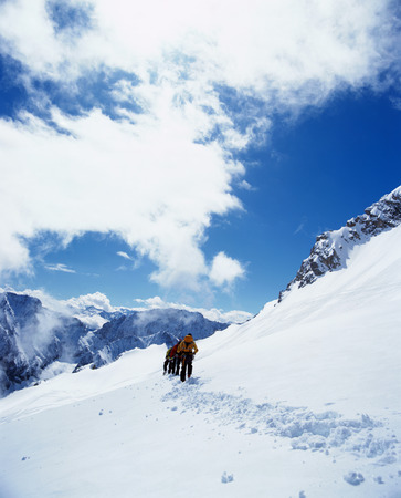 Rear view of hikers on snowy mountain