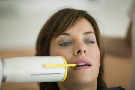 Woman getting dental x-ray LANG_EVOIMAGES