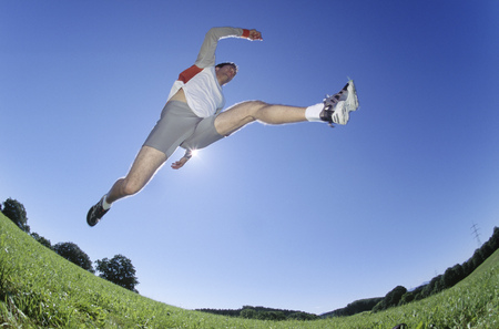 Underview, man jumping