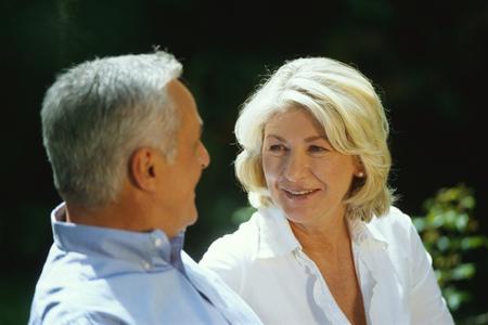 Candid portrait of mature couple in conversation