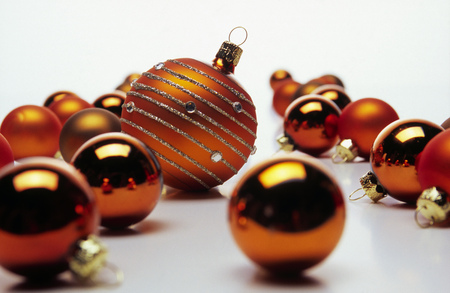 Detail view of one large Christmas ornament amongst smaller ones LANG_EVOIMAGES