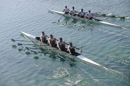 Team of rowers competing LANG_EVOIMAGES