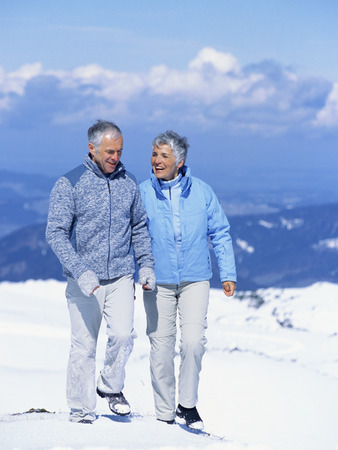 Senior couple walking in snow