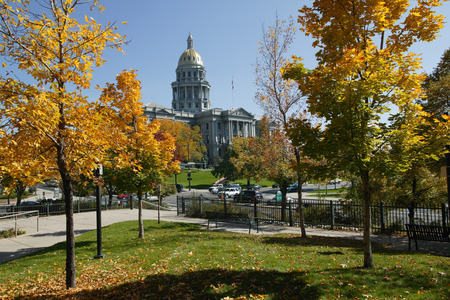 View of the Capitol Building slightly obscured by autumn trees, Denver, Colorado, USA LANG_EVOIMAGES