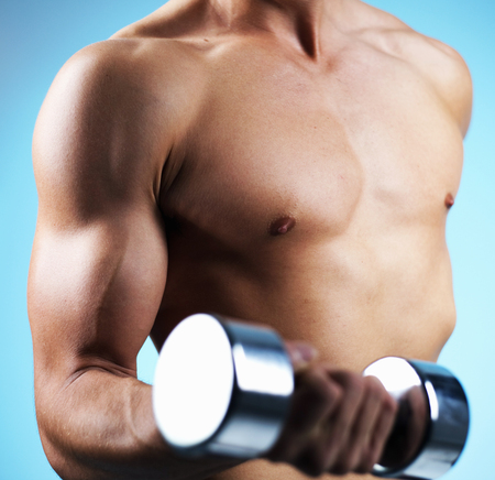 Portrait of a man lifting weights
