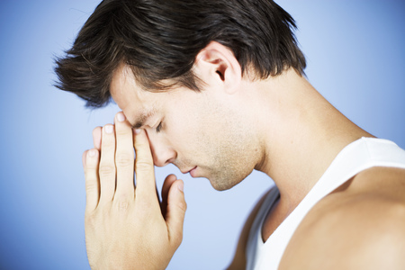 Portrait of a young man praying