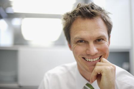 Close up of businessman smiling LANG_EVOIMAGES