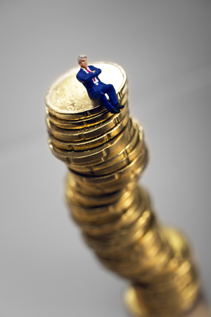 Stack of Euro coins with businessman figurine