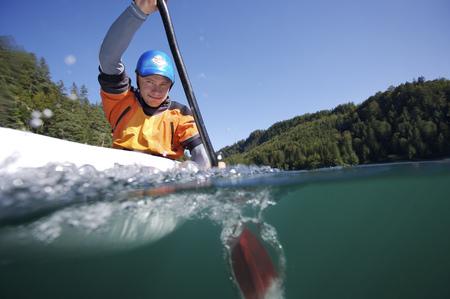 Surface shot of man paddling in kayak