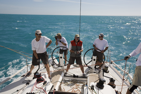 Group of men standing on sailboat in Key West, Florida, USA