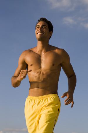 Man jogging outdoors LANG_EVOIMAGES