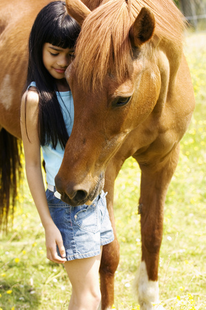 Young girl and horse outdoors