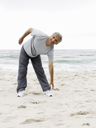 Man stretching at beach