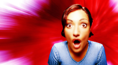 Surprised young woman in front of explosive digital background