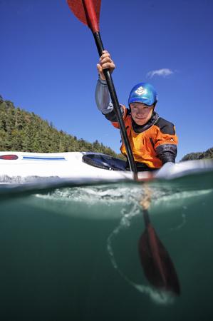 Surface shot of person paddling in kayak