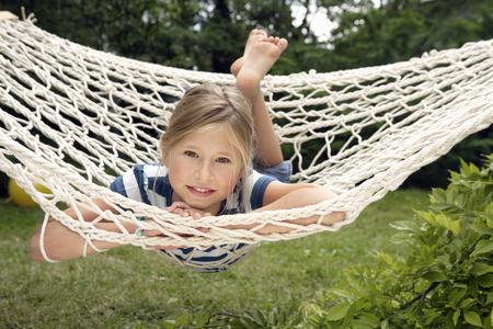 Young girl relaxing in hammock