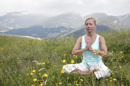 Woman practicing yoga, Kleinwalsertal, Allgau, Germany