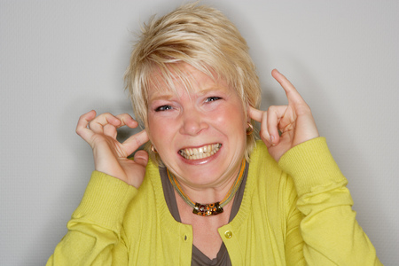Woman plugging ears with fingers