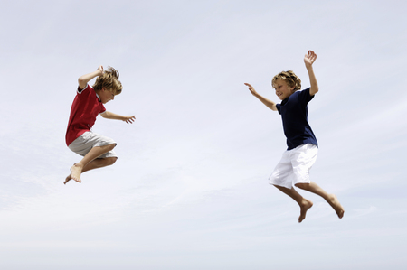 Low angle view of boys jumping