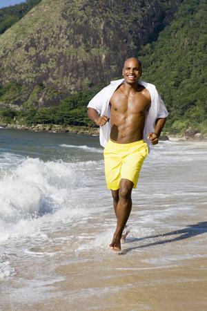 African man running on beach
