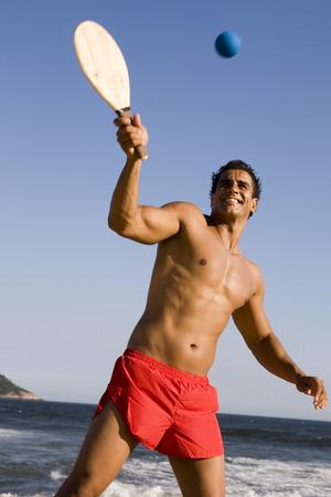 Man playing game at beach