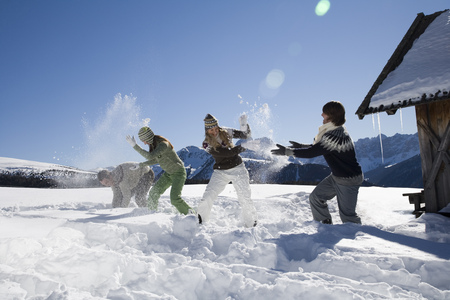 Friends having snowball fight, Luesener Alm, Dolomite Alps, South Tyrol, Italy LANG_EVOIMAGES