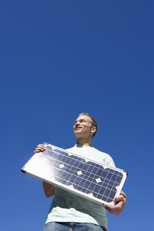 Man with solar panel, low angle view