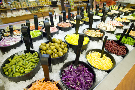 Selection of fresh food in bowls chilled with ice in supermarket (still life) LANG_EVOIMAGES