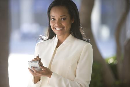 Businesswoman using electronic organizer