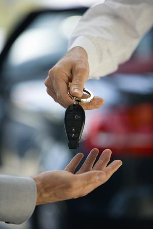 Man getting keys to new car