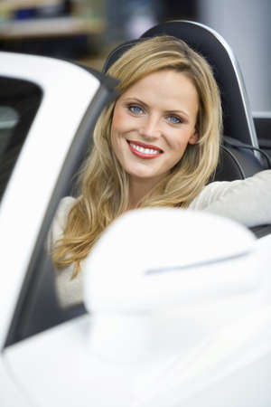 Woman sitting in convertible