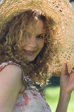 Portrait of woman in sun hat