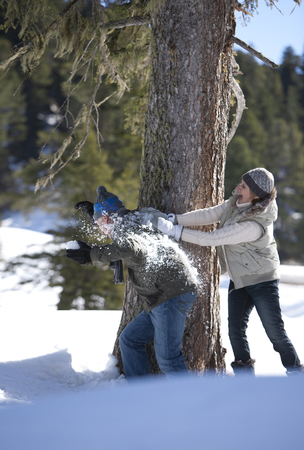 Couple having snowball fight outdoors LANG_EVOIMAGES