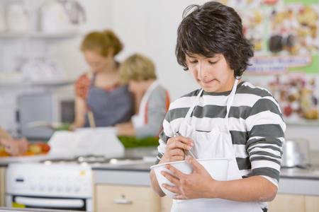 Serious student preparing recipe in home economics class