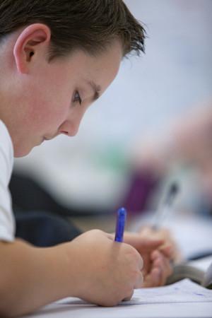 Close up of boy taking test LANG_EVOIMAGES