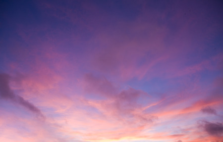 Clouds at sunset in pink and purple sky