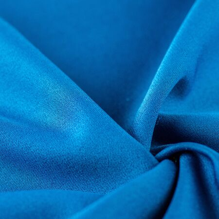 High resolution background texture, decorative basis for design, silk blue fabric to make the desired size or shape by inserting the necessary elements or details.