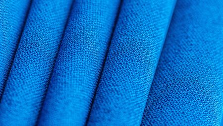 High resolution background texture, decorative basis for design, silk blue fabric to make the desired size or shape by inserting the necessary elements or details. Stock Photo