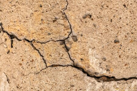 Old concrete cement with cracks and natural destruction from time and weather conditions