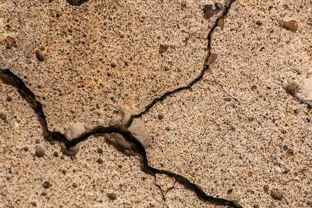 Old concrete cement with cracks and natural destruction from time and weather conditions 版權商用圖片