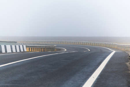 Foggy morning. Tatarstan, Russia, Interstate Highway M7. The road is empty from cars. Interchange on the M7 highway
