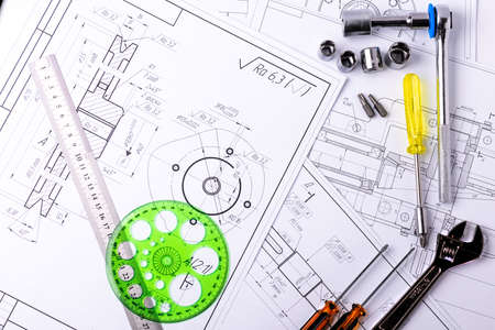 Technical engineering drawings, which show mechanical parts engineering components and assemblies for their manufacture in industry. Factory Industry Industrial work project blueprints measuring caliper, ruler and tools Zdjęcie Seryjne