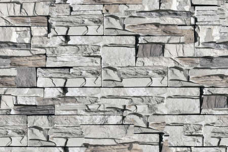 Seamless texture of bricks on the wall in the form of wild stone pattern Background. Beige and brown tones with shadows and deep texture granite or marble. Standard-Bild