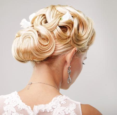 wedding hairstyle: Beautiful bride with fashion wedding hairstyle - on white background