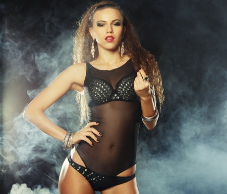 Fashion shoot of young sexy striptease dancer photo